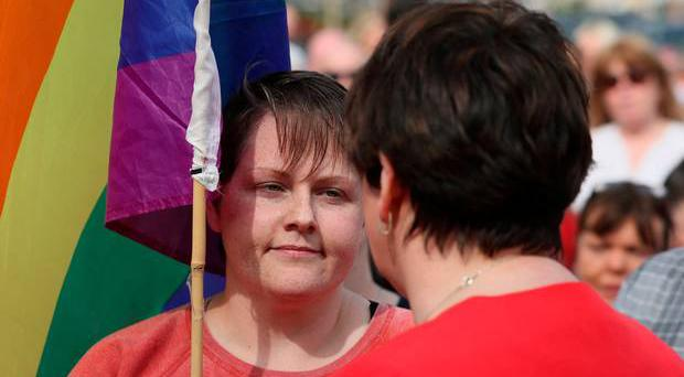 DUP leader Arlene Foster (right) speaks with Sara Canning (left), the partner of 29-year-old journalist Lyra McKee, at a vigil in Derry, following her death last week.