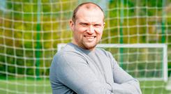 Warren Feeney will stay on as Ards boss