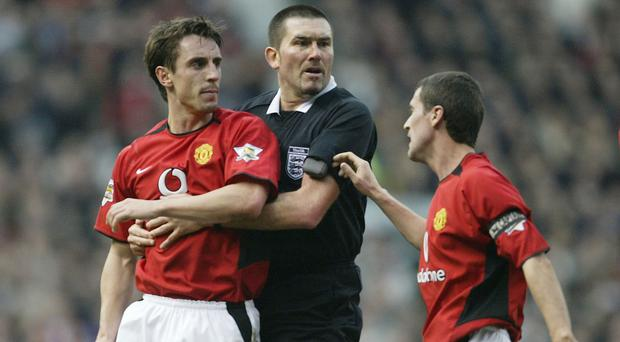 Gary Neville (left) and Roy Keane (right) had a disagreement after Manchester United's defeat to Manchester City