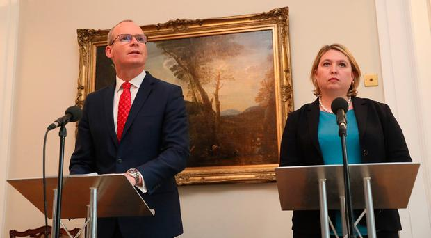 Irish Minister for Foreign Affairs Simon Coveney and Northern Ireland Secretary Karen Bradley during a press conference at Stormont in Belfast. Credit: Brian Lawless/PA Wire