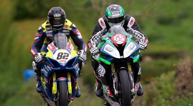 Hot pace: Michael Sweeney leads Derek Sheils during Cookstown 100 qualifying last night