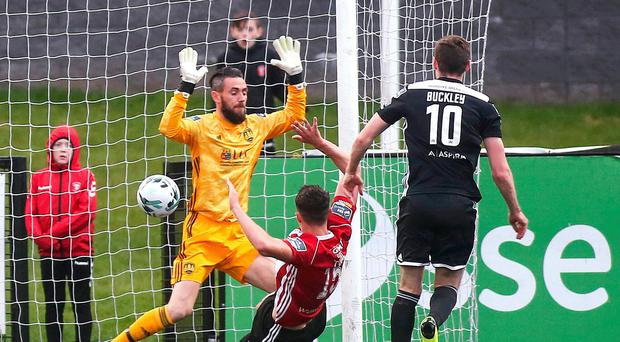 Crucial touch: Eoin Toal scores Derry City's first goal past Cork goalkeeper Mark McNulty