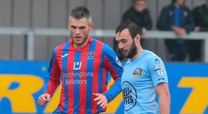 Staying focused: Craig McClean takes on Warrenpoint earlier this season