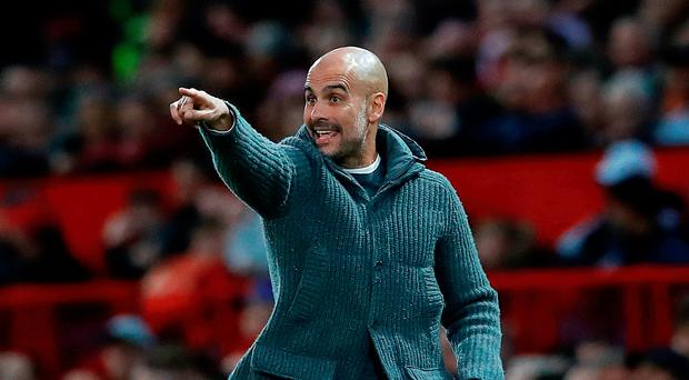 Record breaker: Pep Guardiola's Manchester City have reached similar heights to last year's historic title winning campaign