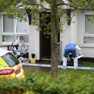 Police and forensic experts at the scene. Photo By Justin Kernoghan