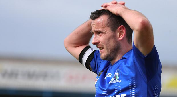 Newry's Mark Hughes shows his frustration as his side are relegated.