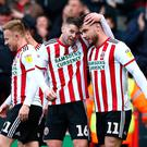 Ollie Norwood (16) celebrates as his side all but secure their place in the Premiership.