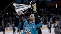 Belfast Giants' Blair Riley pictured with the Elite Ice Hockey League trophy (William Cherry/Presseye)