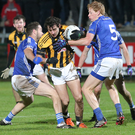 Middle man: Crossmaglen's Jamie Clarke (centre) comes under attention from Scotstown's Mark Duffy, Emmet Caulfield and Damien McArdle