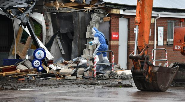 Forensics at the scene after a ATM theft on the Tully Road near Crumlin on Tuesday, April 30.