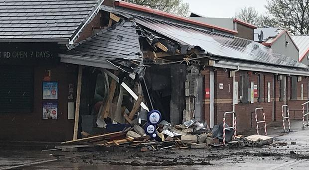 The scene at a fuel station in Nutts Corner, where a digger was used to rip an ATM from the wall (Rebecca Black/PA)