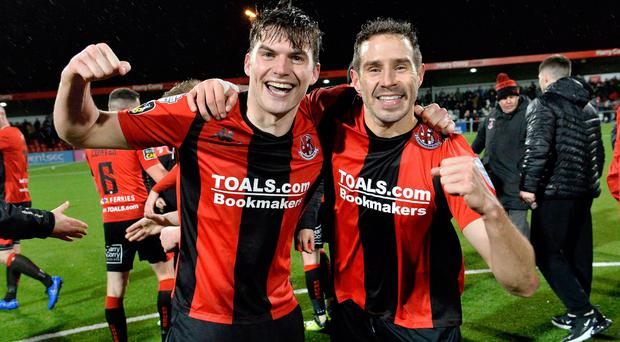 Winners: Philip Lowry (left) and Sean Ward celebrate the County Antrim Shield success this year