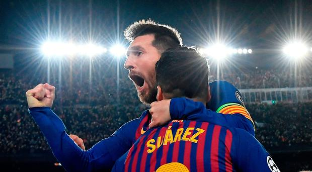 Bright lights: Two goal Lionel Messi and Luis Suarez were on target to stun Liverpool last night