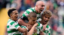 Celtic's Scott Sinclair (left) celebrates with his team-mates (Ian Rutherford/PA Wire)