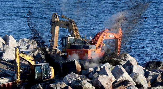 Army carry out a controlled explosion on a suspected war time device at Portrush Harbour on Thursday evening, the device was uncovered during works being carried out at the harbour. Pic Steven McAuley/McAuley Multimedia