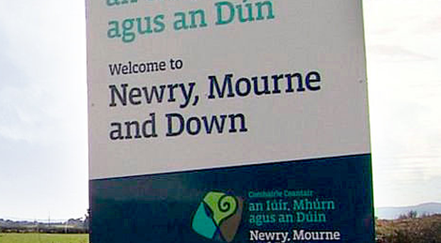 Bilingual: Newry, Mourne and Down road sign in Irish and English