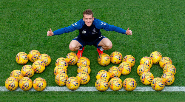 Good deal: Steven Davis celebrates his new one-year contract