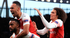 Crucial strike: Pierre-Emerick Aubameyang Alexandre jumps on the back of Alexandre Lacazette after he scored Arsenal's second goal last night
