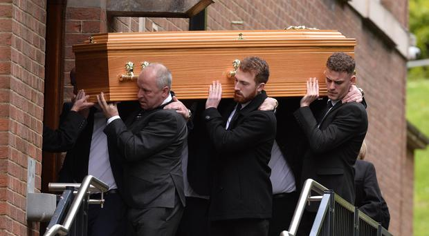 Family and friends during the Funeral for Niall Magee at St Gerard's Church on the Antrim Road in Belfast on Friday. Picture Pacemaker Press