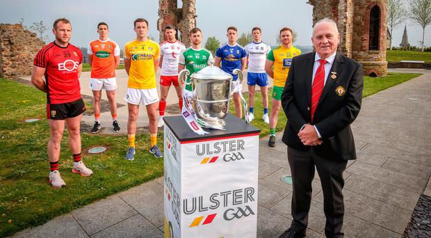 Up for the cup: Ulster GAA President Oliver Galligan at the launch of the Ulster Senior Football Championship with (L-R) Down's Darren O'Hagan, Armagh's Rory Grugan, Antrim's Niall Delargy, Tyrone's Mattie Donnelly, Fermanagh's Ciaran Corrigan, Cavan's Ciarán Brady, Monaghan's Conor McManus and Donegal's Eamon Doherty