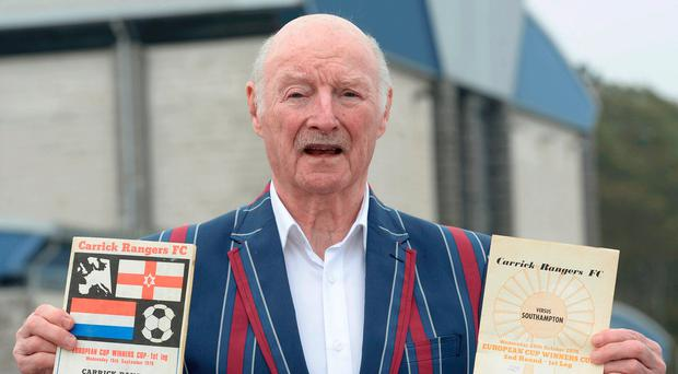 Fond memories: Jimmy Brown with programmes from Carrick's Euro adventure