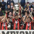 Crusaders captain Colin Coates lifts the Irish Cup (Inpho/Stephen Hamilton)