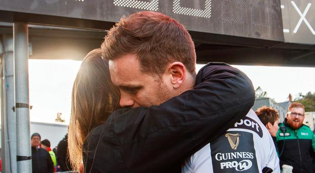 Emotional time: Darren Cave with his wife Helen after the game