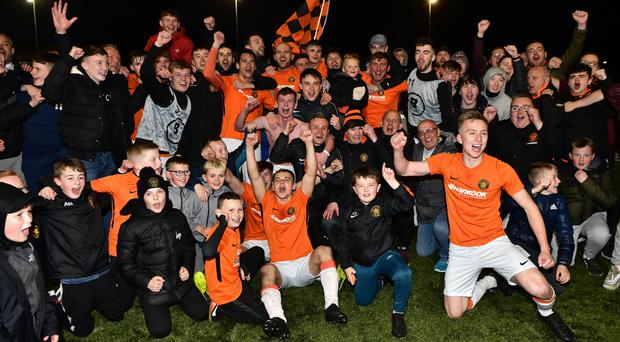 Carrick celebrate winning promotion after this evening's game at the Bangor Fuels Arena (Colm Lenaghan/Pacemaker Press)