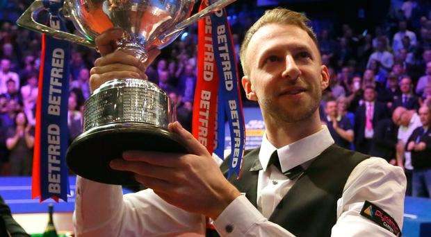 Main man: Judd Trump shows off the world title to fans at the Crucible