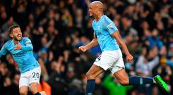 Get in: Vincent Kompany celebrates after his sensational winner against Leicester put Manchester City within touching distance of the Premier League title