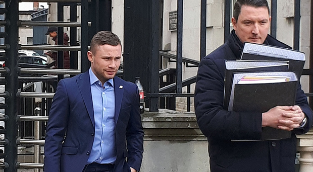 Carl Frampton pictured with his lawyers at the High Court at an earlier hearing in his case against Barry McGuigan.