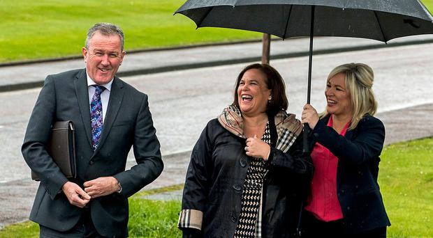 Sinn Fein's Conor Murphy, party leader Mary-Lou McDonald, and deputy leader Michelle O'Neill, walking to speak with media ahead of talks at Stormont House in Belfast