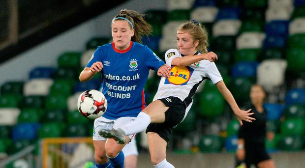 Reunion time: Linfield's Megan Bell is challenged by Glentoran's Ali McMaster during their last meeting in September