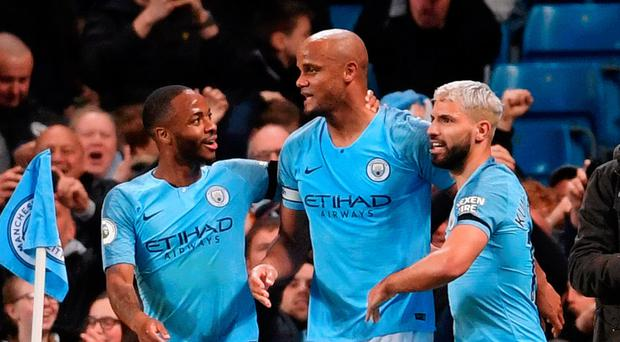 Captain marvel: Vincent Kompany celebrates his wonder goal against Leicester with Raheem Sterling and Sergio Aguero