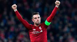 Done it: Jordan Henderson salutes the fans at final whistle