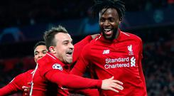 Decisive blow: Xherdan Shaqiri (far left) and Divock Origi celebrate after the latter's second and Liverpool's fourth goal of an extraordinary night