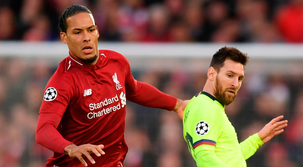Red alert: Virgil Van Dijk with Barcelona's Lionel Messi