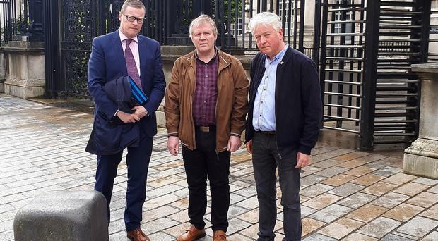 Robert Cunningham (centre) with his solicitor Kevin Winters (left) and Paul O'Connor from the Pat Finucane Centre (right). Credit: Press Eye
