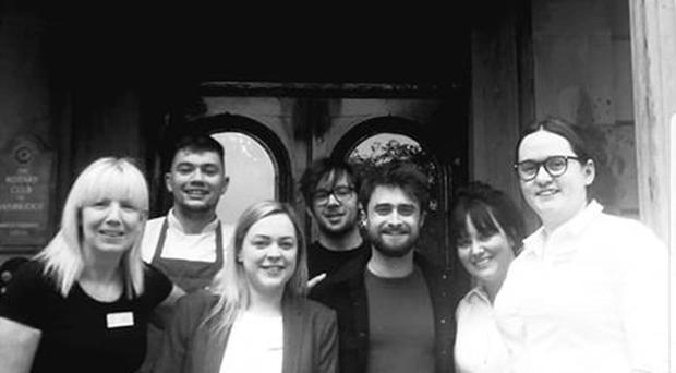 Harry Potter star Daniel Radcliffe with staff at the Belmont House Hotel. Pic Belmont House Hotel