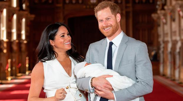 Proud as punch: a beaming Prince Harry with his newborn son Archie