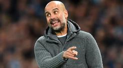 Proud boss: Pep Guardiola is thrilled with City's season, even if they miss out on the title