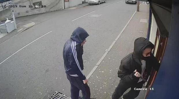 CCTV footage shows the men entering the shop. Credit: Leona O'Neill