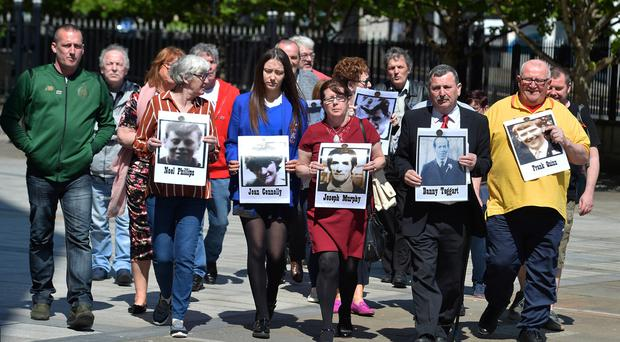 Families in Including John Teggart (Son of Danny Teggart) speak to the media outside Laganside Court on Monday. Pic Colm Lenaghan/Pacemaker