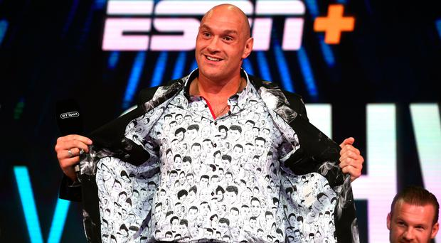 Getting shirty: Tyson Fury at a press conference in London yesterday
