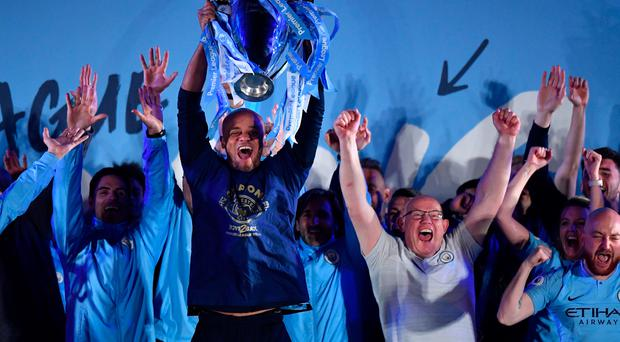 On top: Vincent Kompany show off title outside the Etihad Stadium after City won on Sunday
