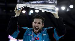 Belfast Giants forward Jordan Smotherman, pictured with the Elite Ice Hockey League trophy, is back for another season with the team (William Cherry/Presseye)