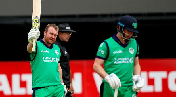 Bright note: Paul Stirling celebrates his century yesterday