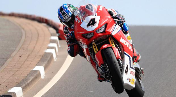 Seeing red: Ian Hutchinson (Honda Racing) at Black Hill during Tuesday's Superbike practice session