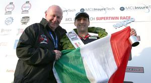PACEMAKER BELFAST 16/05/2019 The first ever Italian winner Stefano Bonetti celebrates winning after this evenings MCL Insuretech Supertwin race at the North West 200. Event director Mervyn Whyte congratulates him Photo Stephen Davison/Pacemaker Press