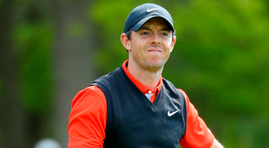 Tough day: Rory McIlroy shows his frustration